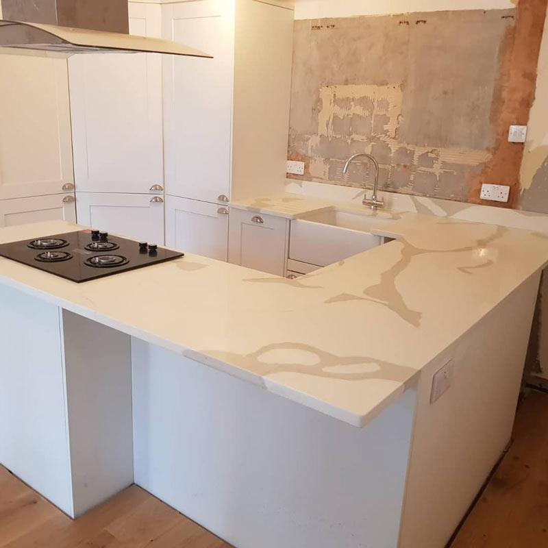 Chichester Granite designs granite and quartz kitchen worktops for Guildford