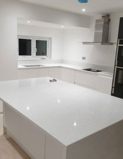 Kitchen island with white mirror quartz worktop