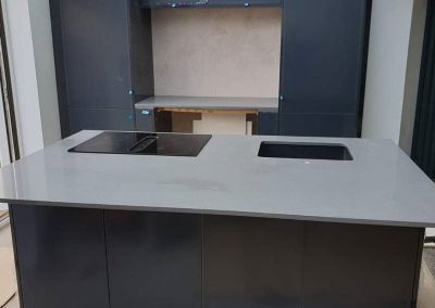 Grey quartz kitchen worktop with island